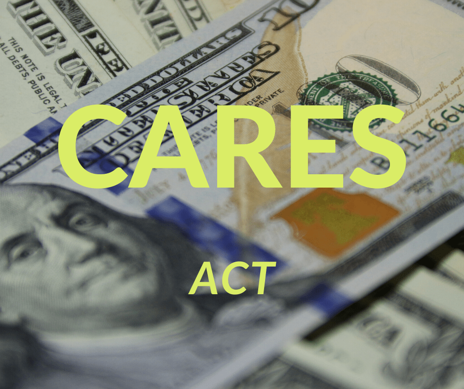 Dollars with CARES Act written on it