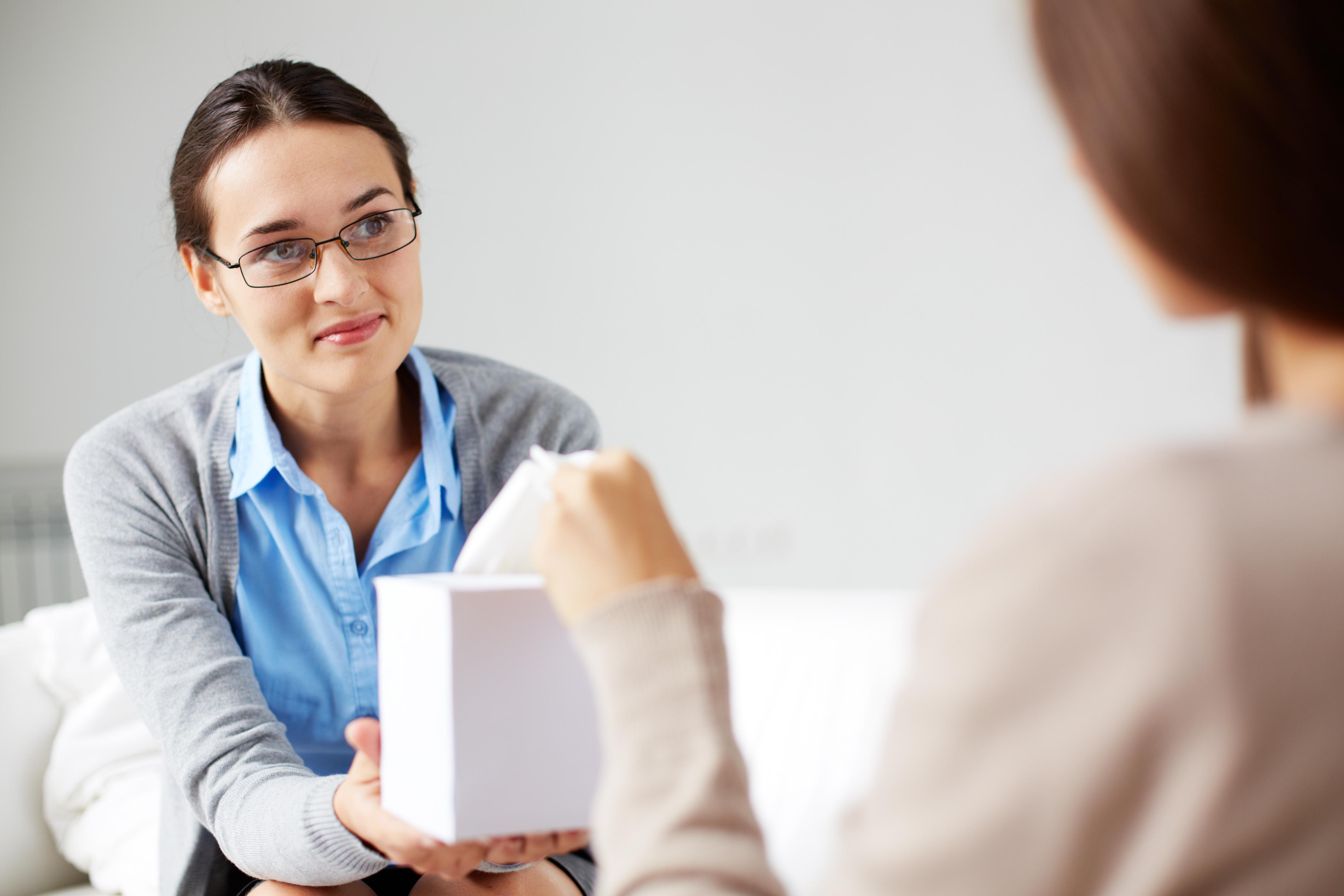 Counselor Holding Tissues for Client